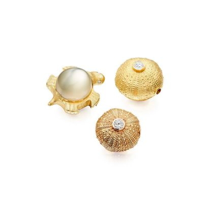 Interchangeable sea urchin and tortoise clasps. Pearls can be adapted to fit our clasps